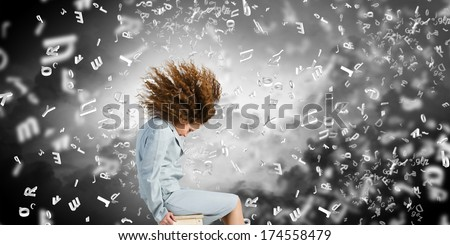 Young sitting businesswoman with waving hair. Crisis concept - stock photo