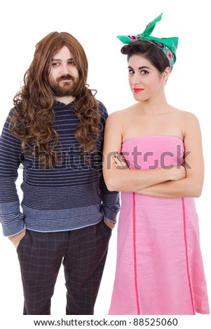 young sixties couple isolated, studio picture, focus on the woman - stock photo