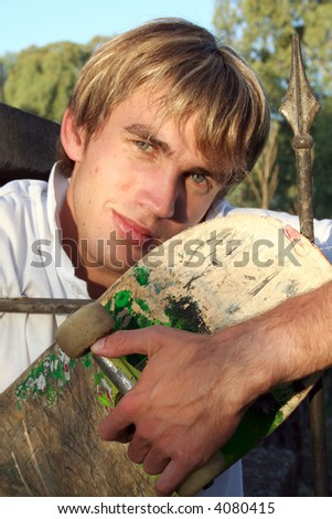 young skate dude with skateboard - stock photo