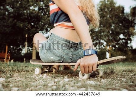 Young skateboarder girl resting outdoor - stock photo