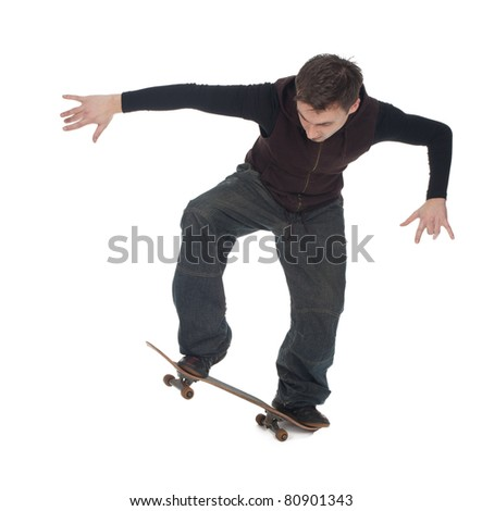 young skateboarder in dark clothes with his skateboard - stock photo