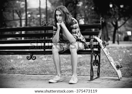 Young skateboarder in the park - stock photo