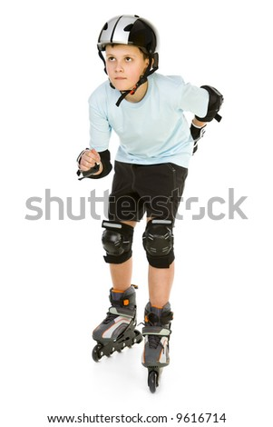 Young skater boy ready to ride on roller skates. He's looking at something. Front view. Isolated on white background. - stock photo
