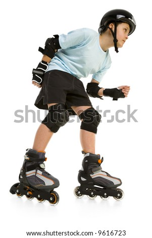 Young skater boy ready to ride on roller skates. He's looking at something. Side view. Isolated on white background.