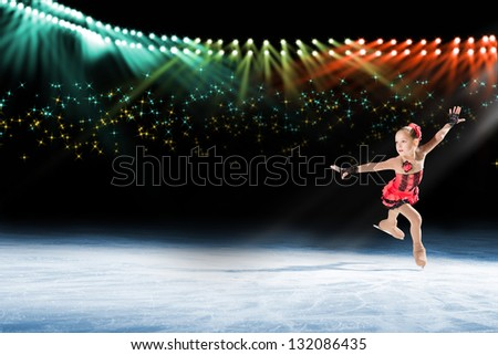 young skater performs on the ice in the background lights lighting - stock photo