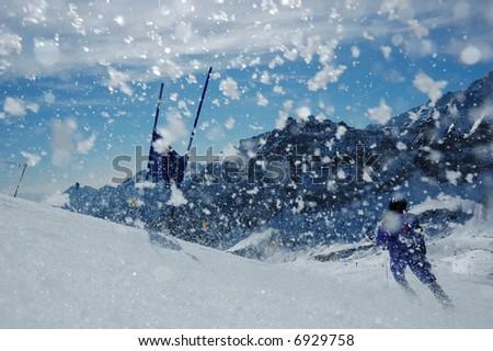 Young ski racer doing downhill slalom - stock photo
