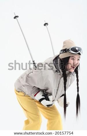 Young Ski Woman in Winter