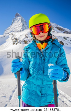 Young skier girl with view of Matterhorn on a clear sunny day - Zermatt, Switzerland - stock photo