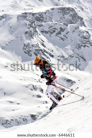 Young Skier going downhill
