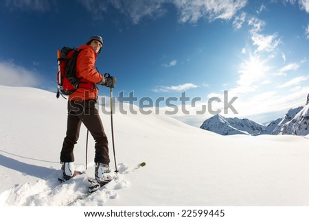 Young skier ready for skiing, italian alps; horizontal frame - stock photo