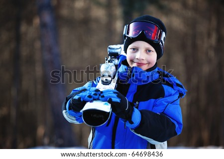 Young skier with ski - stock photo