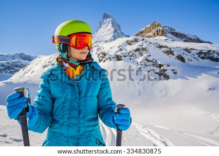 Young skier with view of Matterhorn on a clear sunny day - Zermatt, Switzerland - stock photo