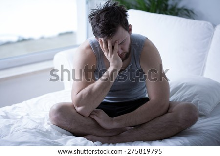 Young sleepy man exhausted in the morning - stock photo