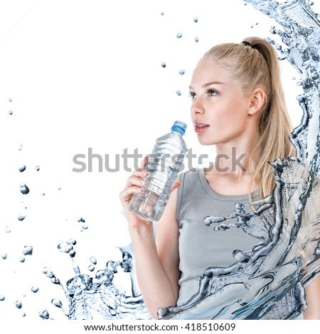 Young slender woman with plastic water bottle isolated over white background - stock photo