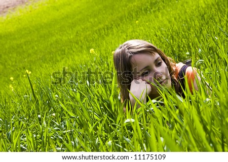 Young slept woman trough the grass - stock photo