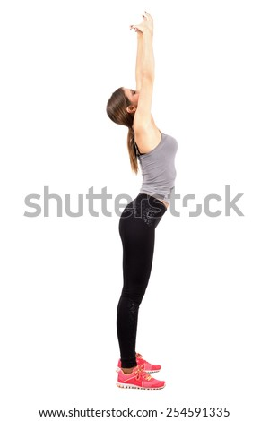 Young slim and fit woman stretching back with arms raised up. Profile view. Full body length portrait isolated over white background.