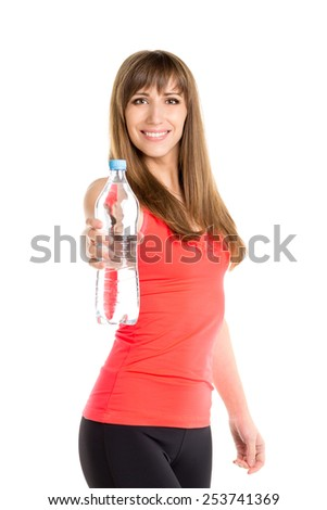 Young slim caucasian woman holding a bottle of fresh water. Smiling fitness girl isolated on white background - stock photo