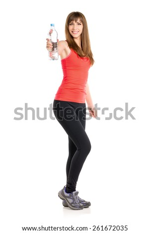 Young slim caucasian woman holding bottle of fresh water. Fitness girl isolated on white background - stock photo