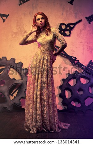 Young slim fashion woman on clock background. - stock photo