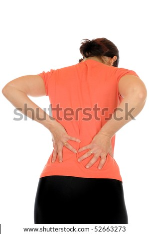 Young slim female has backache - stock photo