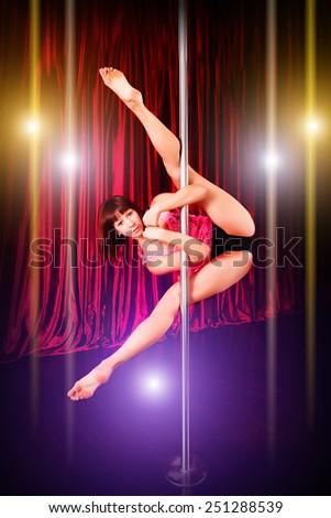 Young slim pole dance woman. - stock photo