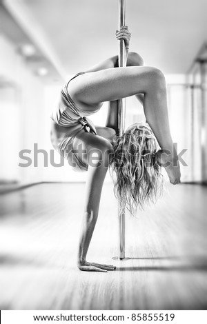 Young slim pole dance woman. Black and white.