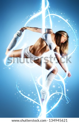 Young slim pole dance woman with lights. - stock photo