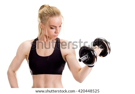 Young slim strong muscular woman posing in studio with dumbbell on white background