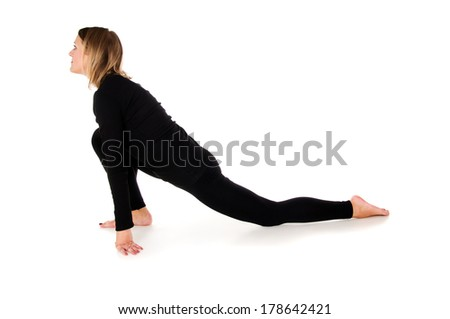 Young slim woman doing exercise isolated - stock photo