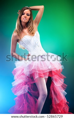 Young slim woman in red dress. - stock photo