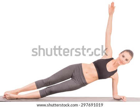 Young slim woman in studio practicing yoga and relaxing. - stock photo