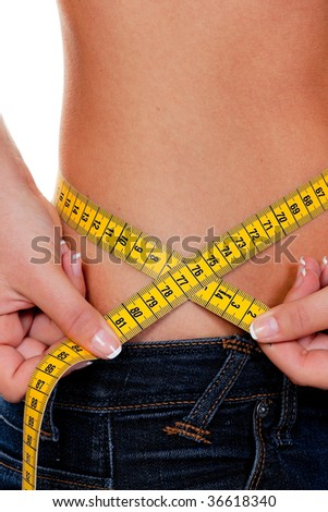 Young, slim woman with measuring tape measure their Body: - stock photo