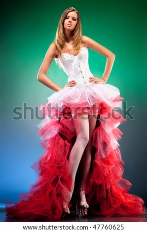 Young slim woman with red dress. - stock photo