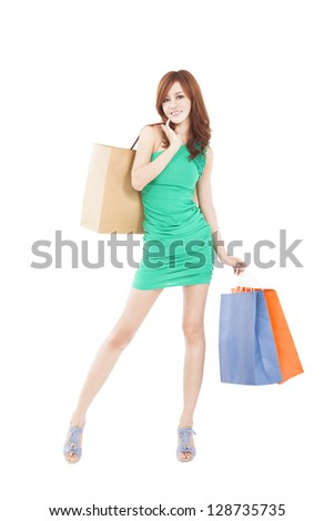young slim woman with shopping bags - stock photo