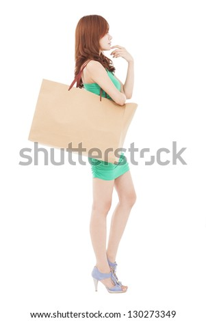 young slim woman with shopping bags and thinking - stock photo