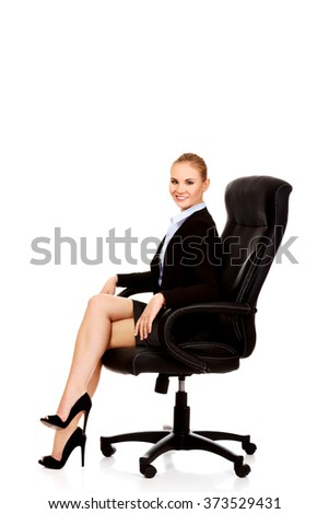 Young smile business woman sitting on a chair in office - stock photo