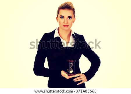 Young smile businesswoman with hourglass - time concept - stock photo