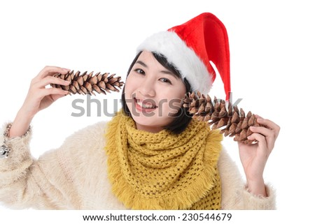 young smile woman in red wearing santa hat holding Pine cone - stock photo