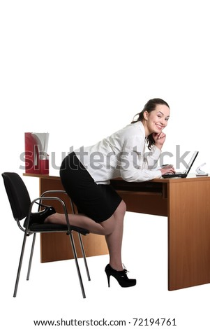 Young smiley businesswoman work on her laptop - stock photo