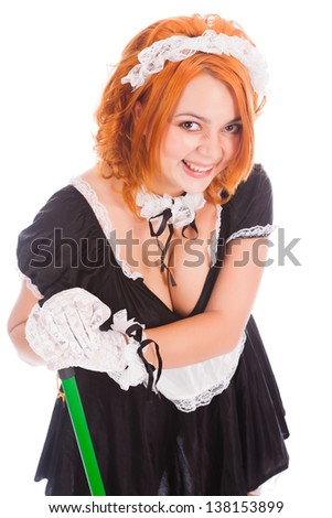 Young smiley charwoman with brush - stock photo