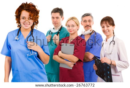 young smiley female doctor and her team. five female an male doctors - stock photo
