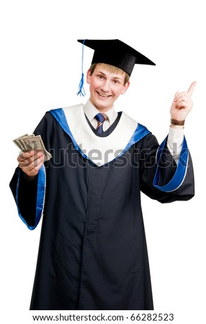 Young smiley graduate student in cloak with money and thumbs up isolated