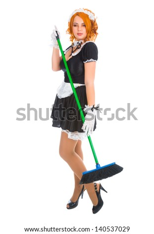Young smiley housewife with with brush in hand - stock photo