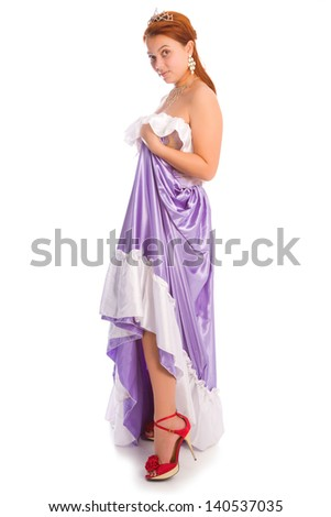 Young smiley woman in long lilac-coloured ball dress - stock photo