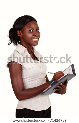 young smiling African American businesswoman wearing light shirt with a diary - stock photo