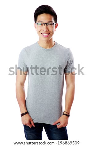 Young smiling asian man standing over white background - stock photo