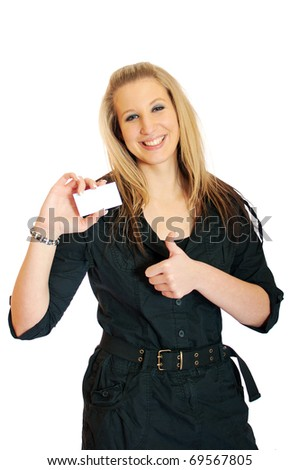 Young smiling beautiful business woman showing a blank business card and thumbs up over white background. good job - stock photo
