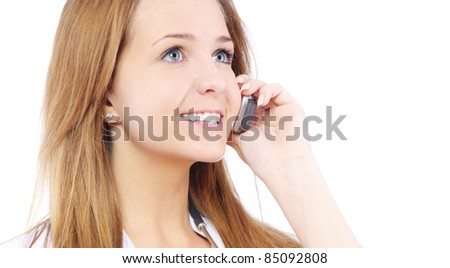 Young smiling beautiful woman-nurse with stethoscope talks by mobile phone, isolated on white background. - stock photo