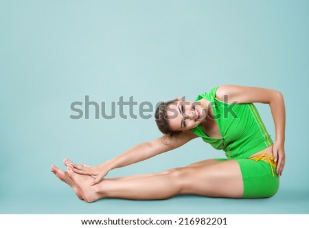 Young smiling beautiful woman training fitness stretch - stock photo