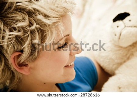 Young smiling beauty with teddy bear. - stock photo